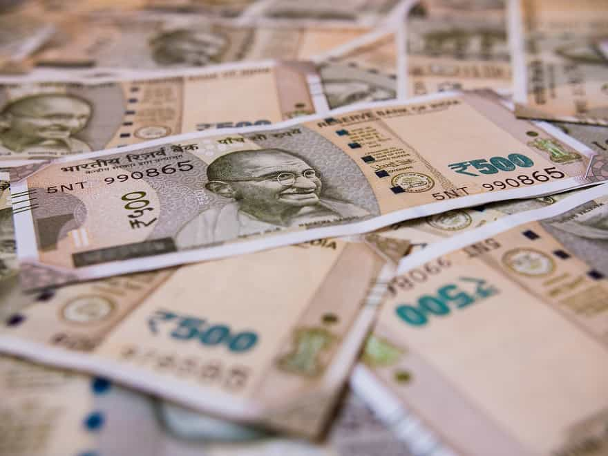 Indian money with 500 rupee bills in unfolded form