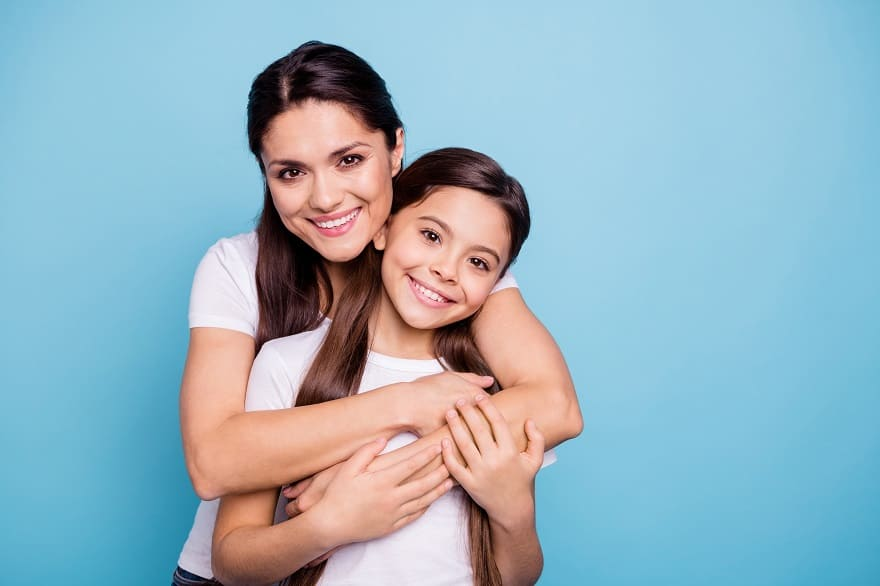 Moving to the UK - Beautiful Mother and Daughter on blue background