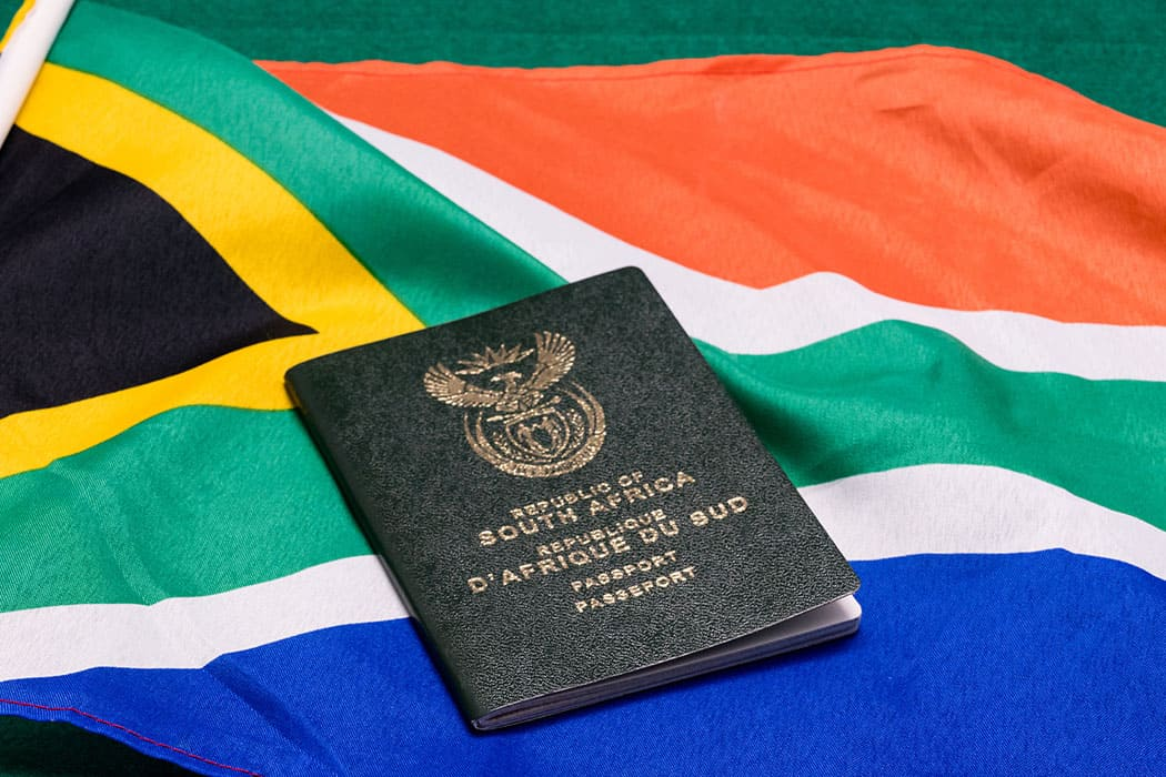 Moving to South Africa - South African passport on SA flag